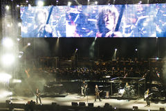 Ligabue in Concert. Ligabue singing and playing guitar with his band with a hudge TV screen during one of his concert in arena di Verona - Italy 2007 Royalty Free Stock Photos