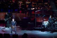 Ligabue in Concert. Ligabue singing and playing guitar with his band during one of his concert in arena di Verona - Italy 2007 Stock Photo