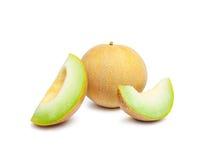 Ligamaza del melón y dos rebanadas del melón Imagenes de archivo