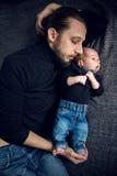 Ligga för fader och för son Arkivfoto