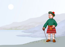 liggande scotland Arkivfoton