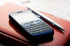 liggande telefon för dagbok Arkivfoton