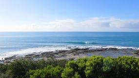 ligganden vaggar havet Arkivbild