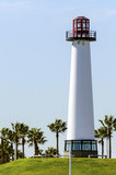 Lighthouse. A lighhouse near the beach surrounded by palm trees Stock Photos