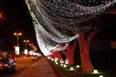 Lighing on trees on 42nd National day celebration at Bahrain. MUHARRAQ, BAHRAIN - DECEMBER 17: Beautiful illumination and decoration on 17 December, 2013 on the stock image