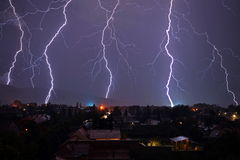 Lighning bolt over night sky in central europe. Stock Photography
