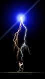 Lighning bolts and man. Man fighting off lightning bolts , nature Royalty Free Stock Photography