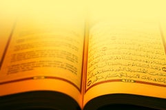 Light. Opened Koran inside old writing royalty free stock photo