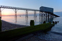 Before the light. Lifeboat station just before the sun rises above the horizon Stock Photos