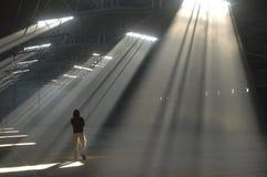 Light. Man Walking on Focus Light Stock Photo