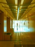 Into the Light. Ghostly colors and a shadowy person in this hallway Stock Photography