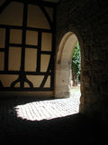 Into the light. Entrance of a monastery building royalty free stock image