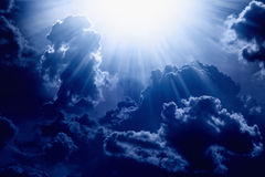 Light from above. Dramatic background - dark blue sky with bright sun, light from heaven Stock Photography