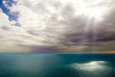 Light above a sea Stock Images