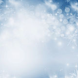 Light abstract Christmas background. With white snowflakes Stock Images
