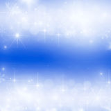 Light abstract Christmas background. With white snowflakes Royalty Free Stock Photo