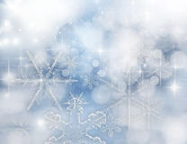 Light abstract Christmas background. With white snowflakes Royalty Free Stock Images