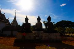 Silhouette Thai buddha statues at the temple in Thailand. Light abstract silhouette Thai buddha statues at the temple in Thailand Royalty Free Stock Photography