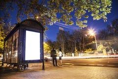 Light Advertising street. Bus Shelter Billboard at Night light stock images