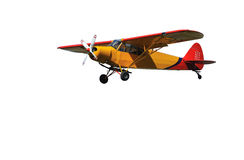 Light Aircraft. Light 2-seater aircraft in red and orange with smart pilot in blue suit. Isolated on against a white background royalty free stock image
