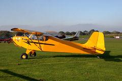 Light aircraft. Light airplane in grassy airfield Stock Photos