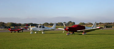 Light aircraft. Light airplanes in grassy airfield Royalty Free Stock Image