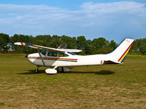 Light aircraft. Parked on a grass field royalty free stock photos