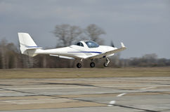 A light aircraft above runway Stock Photo