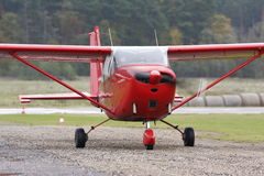 Light aircraft Cessna C-172 Skyhawk. Red coloured light aircraft Cessna C-172 Skyhawk taxiing from runway to apron, airfield Adazi, Latvia royalty free stock photos