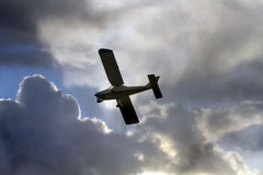 Light aircraft in the clouds Stock Image