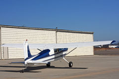 Light aircraft in front of hangar Stock Photo