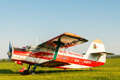 Light aircraft on a green field. Stock Photos
