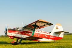 Light aircraft on a green field. Stock Photos
