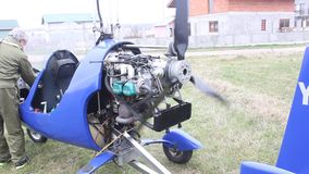 Light aircraft - gyrocopter. Pilot is trying to start propeller  aircraft stock video