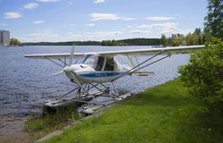 Light aircraft IKARUS C-42 at the shore of the lake. Savonlinna, Finland Royalty Free Stock Photo