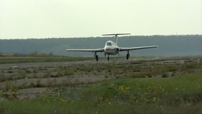 Light aircraft on a runway view. Light aircraft with a pilot in a cabin on a runway view stock video