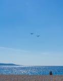 Light aircraft planes flying over Zlatni Rat beach, Croatia Royalty Free Stock Photo
