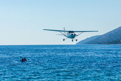 Light aircraft plane flying over Zlatni Rat beach, Croatia Stock Photo