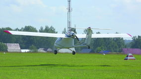 Light aircraft. Light single-engined aircraft landing onto the airfield at the Mochishe Airshow near Novosibirsk, Russia stock video