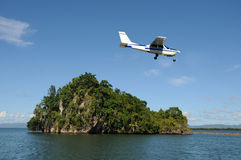 Light airlane landing on island Royalty Free Stock Image