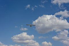 Airplane against the blue sky Royalty Free Stock Photography
