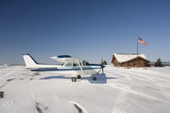 Light airplane on airport in winter stock image