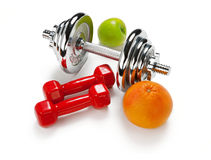 Light And Heavy Dumbbells With Green Apple Ang Grapefruit Royalty Free Stock Photo