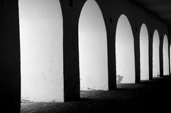 Light arches. Black and white arhces in stone Stock Images