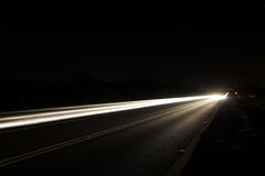 Light arrow. Long exposure of a road by night royalty free stock images