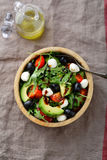 Light Avocado Salad with cherry tomatoes, mozzarella, olive and Stock Photo