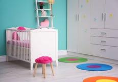 Light baby room interior. With crib royalty free stock photo