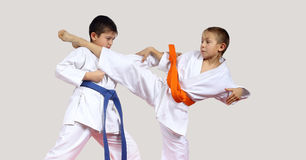 On a light background athletes are hitting blows arms and legs Royalty Free Stock Image