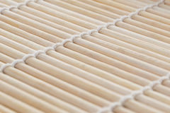 Light background of bamboo sticks. Sushi mat of bamboo as a backdrop Stock Photo