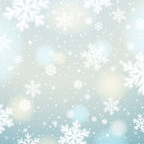 Light background with bokeh and blurred snowflakes, vector Royalty Free Stock Photography